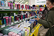 Customers look at thermos flasks at Tokyu Hands, a household gods store in Tokyo, Japan on 27 March 2011. .Photographer: Robert Gilhooly
