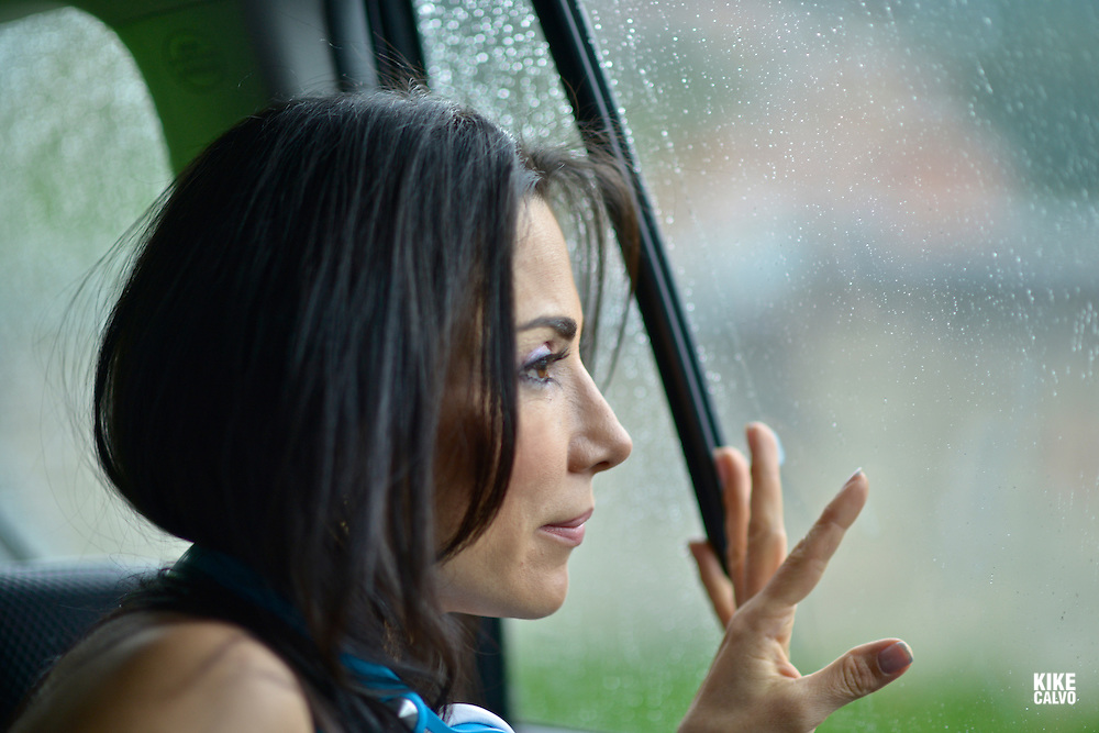 Hispanic woman in her forties looking at rain drops inside a car.  May 29, 2014. (Kike Calvo via AP Images)