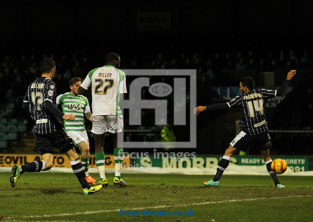 Joe Ralls (2nd left) of Yeovil Town scores his sides first goal during the Sky Bet Championship match at Huish Park, Yeovil<br /> Picture by Tom Smith/Focus Images Ltd 07545141164<br /> 11/02/2014