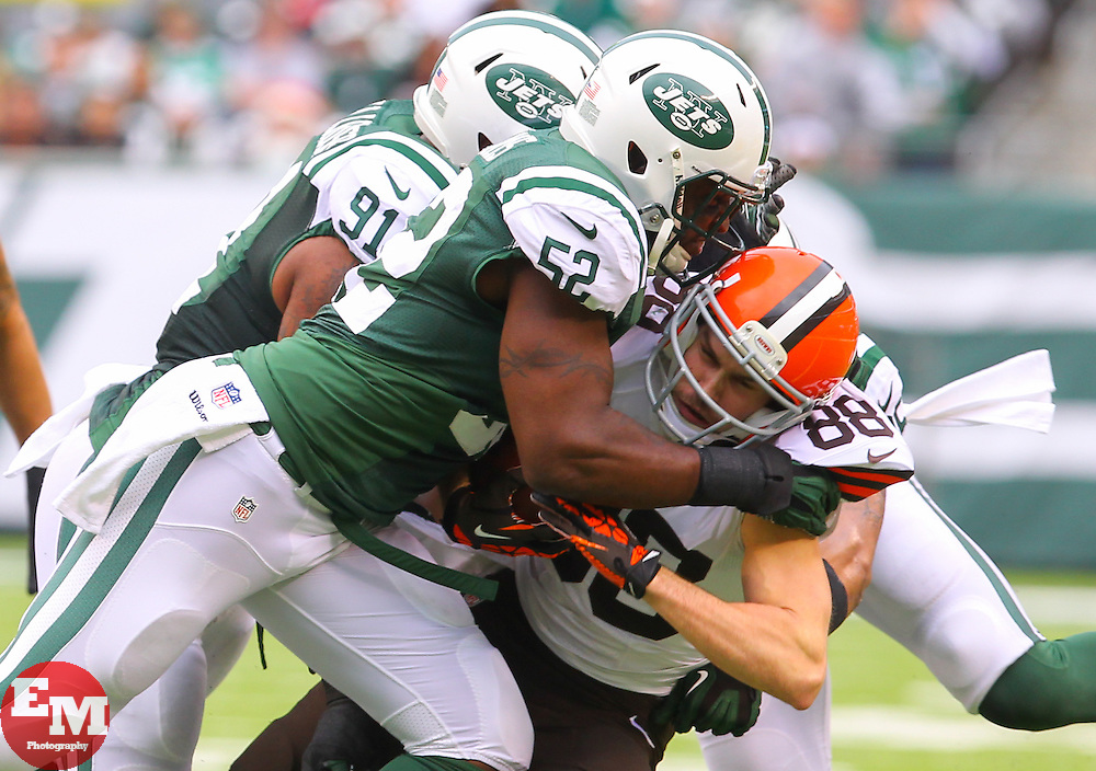 Dec 22, 2013; East Rutherford, NJ, USA; Cleveland Browns wide receiver Josh Cooper (88) is tackled by New York Jets inside linebacker David Harris (52) after catching a pass during the first half at MetLife Stadium.