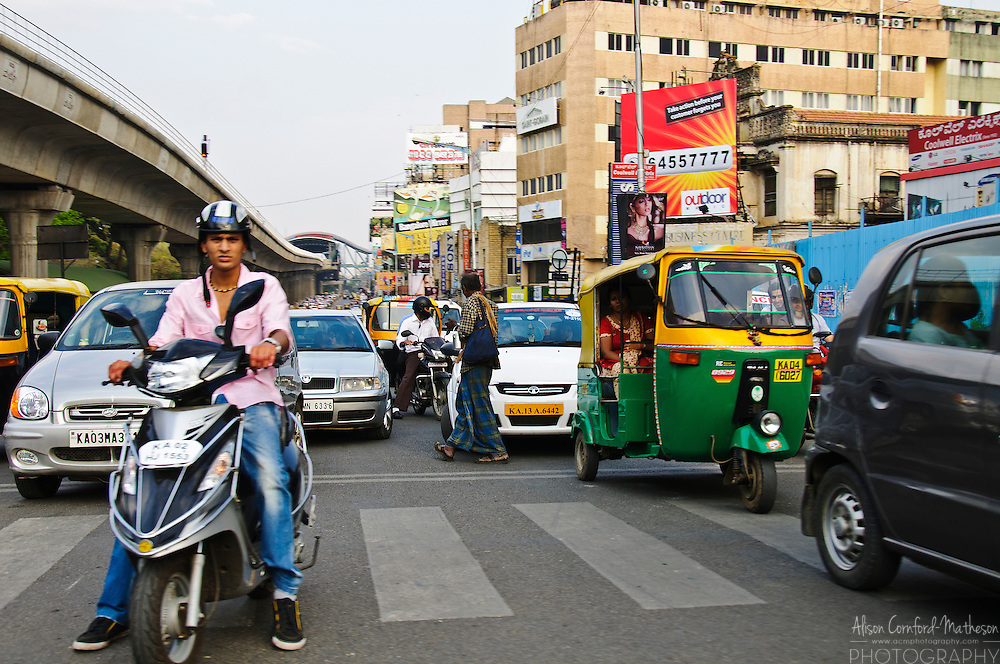 Traffic on M.G. Road in Bangalore, India takes all forms from scooters, to cars and trucks.