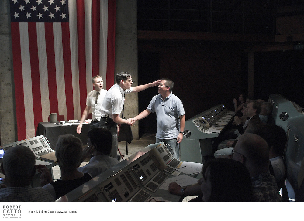 """APOLLO 13: Mission Control takes audiences on a rollicking caper through space and beyond. Winner of two Chapman Tripp Theatre Awards in 2008, this interactive production is lauded by critics, and loved by audiences, for its innovation and imaginative design...As three astronauts trapped 200,000 miles from earth fight for their lives, audience members seated in 'Mission Control' must make the critical decisions necessary to bring the heroes safely home. In command of this epic adventure is Flight Director, Gene Kranz, who lives by the simple belief that """"Failure is not an option""""...To deliver a truly inter-galactic experience, the theatre is transformed into an authentic 1970s replica of Mission Control, complete with retro computers, giant video screens, and elaborate consoles. Seats are also available in the 'Press Gallery' for those who prefer a quieter trip into lunar orbit."""