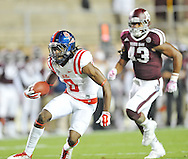 Mississippi Rebels wide receiver Quincy Adeboyejo (8) makes a 31 yard catch against Texas A&M Aggies linebacker Justin Bass (43) in College Station, Texas on Saturday, October 11, 2014.