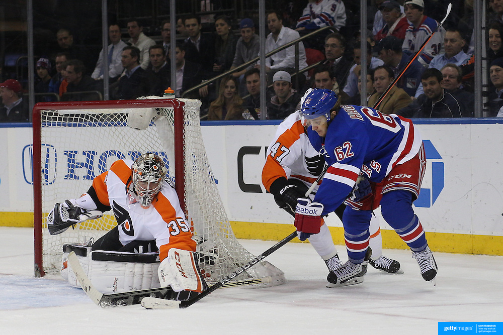 Carl Hagelin, (right), New York Rangers, in action during the New York Rangers Vs Philadelphia Flyers, NHL regular season game at Madison Square Garden, New York, USA. 26th March 2014. Photo Tim Clayton