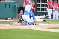 Mississippi's Matt Smith is tagged out by Memphis catcher Shawn Ablett at Autozone Park in Memphis, Tenn. on Tuesday, April 13, 2010. Memphis won 6-5.