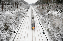 © Licensed to London News Pictures. 01/02/2019. Reading, UK. A train heads to London on snow covered tracks after overnight snow falls and continuing low temperatures. Photo credit: Peter Macdiarmid/LNP
