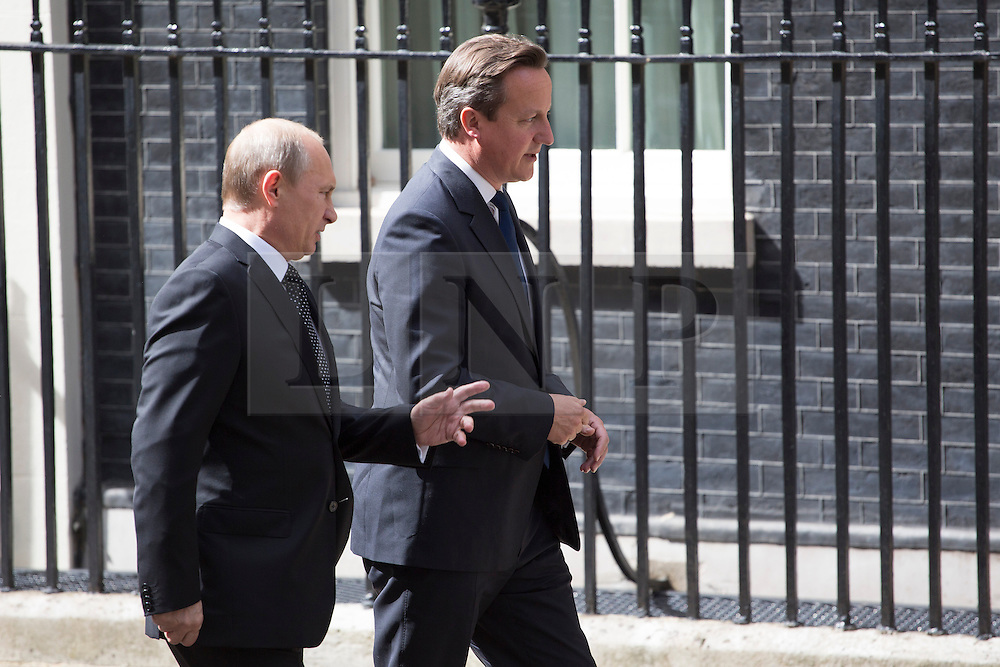 © licensed to London News Pictures. London, UK 16/06/2013. Russian President Vladimir Putin arrives at Downing Street for talks with David Cameron ahead of the G8 summit on Sunday, 16 June 2013. Photo credit: Tolga Akmen/LNP