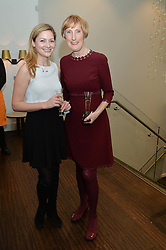 Left to right, KATHRYN PARSONS and PATRICIA VAZ at a dinner in honour of Veuve Clicquot Business Woman Award UK Previous Winners held at Moet Hennessy, 18 Grosvenor Gardens, London on 8th April 2014.