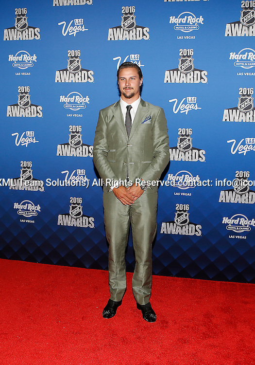2016 June 22: Ottawa Senators captain Erik Karlsson poses for a photograph on the red carpet during the 2016 NHL Awards at the Hard Rock Hotel and Casino in Las Vegas, Nevada. (Photo by Marc Sanchez/Icon Sportswire)