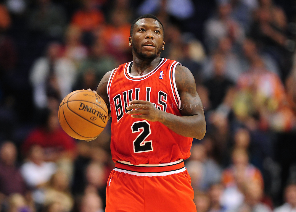 Nov. 14, 2012; Phoenix, AZ, USA; Chicago Bulls guard Nate Robinson (2) dribbles the the ball up the court during the game against the Phoenix Suns at the US Airways Center. The Bulls defeated the Suns 112-106 in overtime. Mandatory Credit: Jennifer Stewart-USA TODAY Sports