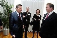 18 APR 2005, BERLIN/GERMANY:<br /> Gerhard Schroeder (L), SPD, Bundeskanzler, und Utz Claassen (R), Vorstandsvorsitzender EnBW, 5. Innovationsgipfel der Partner fuer Innovation, Hauptstadtrepraesentanz Deutsche Telekom AG<br /> IMAGE: 20050418-02-006<br /> KEYWORDS: Gerhard Schröder