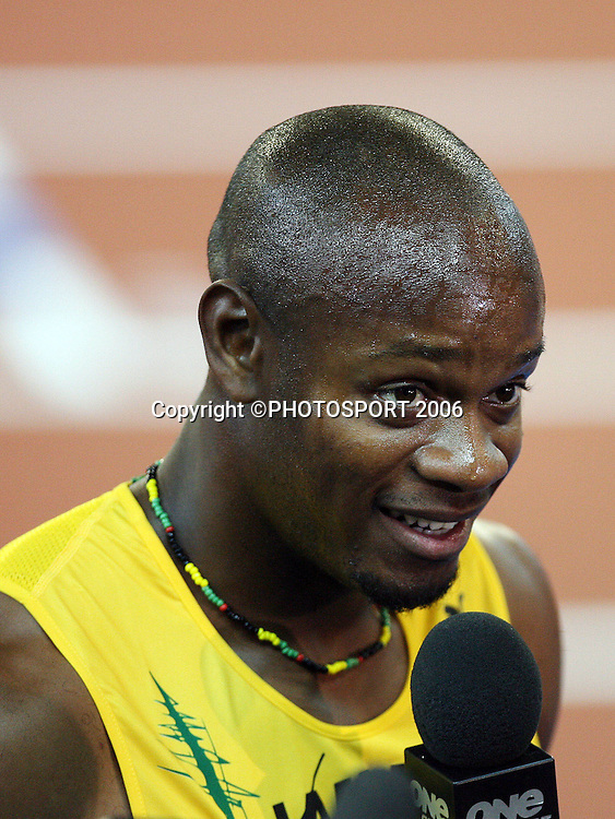 Jamaican athlete Asafa Powell (JAM) talks to the press after winning the Men's 100M sprint on Day 5 of the XVIII Commonwealth Games at the MCG, Melbourne, Australia on Monday 20 March, 2006. Photo: Hannah Johnston/PHOTOSPORT<br />