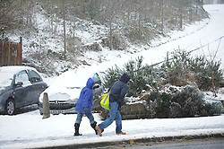 © Licensed to London News Pictures. 05/02/2013. Sheffield, Uk. People struggle through the snow in Pitsmooor, Sheffield. The people of Sheffield woke up to yet more heavy snow this morning. Photo credit : David Mirzoeff/LNP