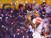INDIANAPOLIS, IN - FEBRUARY 05:  Devin Thomas #15 of the New York Giants hold the trophy after the Super Bowl XLVI at Lucas Oil Stadium on February 5, 2012.(AP Photo/Tom Hauck)