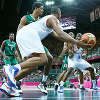 06 August 2012: France Boris Diaw drives past Nigeria Al-Farouq Aminu and passes the ball to Ali Traore during 79-73 Team France victory over Team Nigeria, during the men's basketball preliminary, at the Basketball Arena, in London, Great Britain.