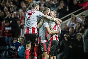Sunderland Chris Maguire celebrates Charlie Wyke's goal during the EFL Sky Bet League 1 match between Rochdale and Sunderland at the Crown Oil Arena, Rochdale, England on 20 August 2019.