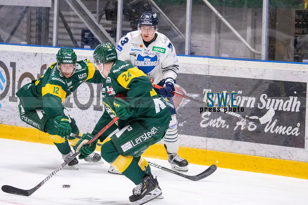 2019-10-09   Umeå, Sweden:Björklöven 12 Brian Cooper battles for the puck with BIK 73 Oliver Eklind in   HockeyAllsvenskan during the game  between Björklöven and Karlskoga at A3 Arena ( Photo by: Michael Lundström   Swe Press Photo )<br /> <br /> Keywords: Umeå, Hockey, HockeyAllsvenskan, A3 Arena, Björklöven, Karlskoga, bk191009