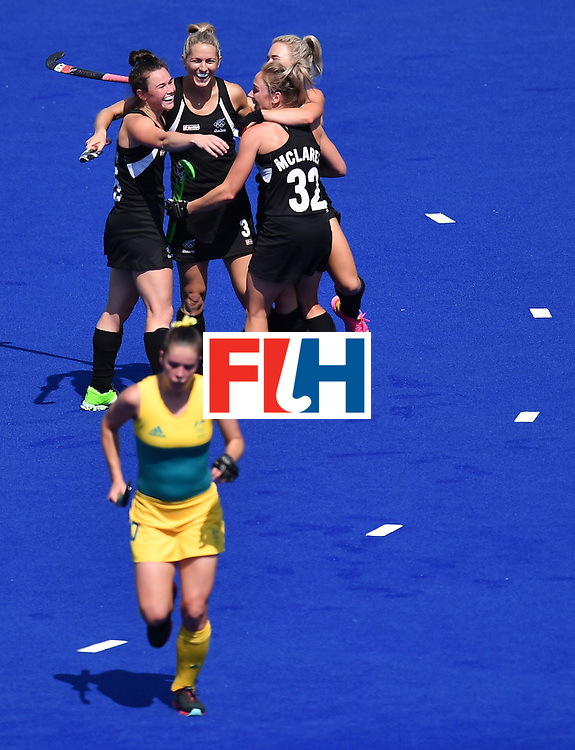 New Zealand's players celebrate their fourth goal during the the women's quarterfinal field hockey New Zealand vs Australia match of the Rio 2016 Olympics Games at the Olympic Hockey Centre in Rio de Janeiro on August 15, 2016. / AFP / MANAN VATSYAYANA        (Photo credit should read MANAN VATSYAYANA/AFP/Getty Images)