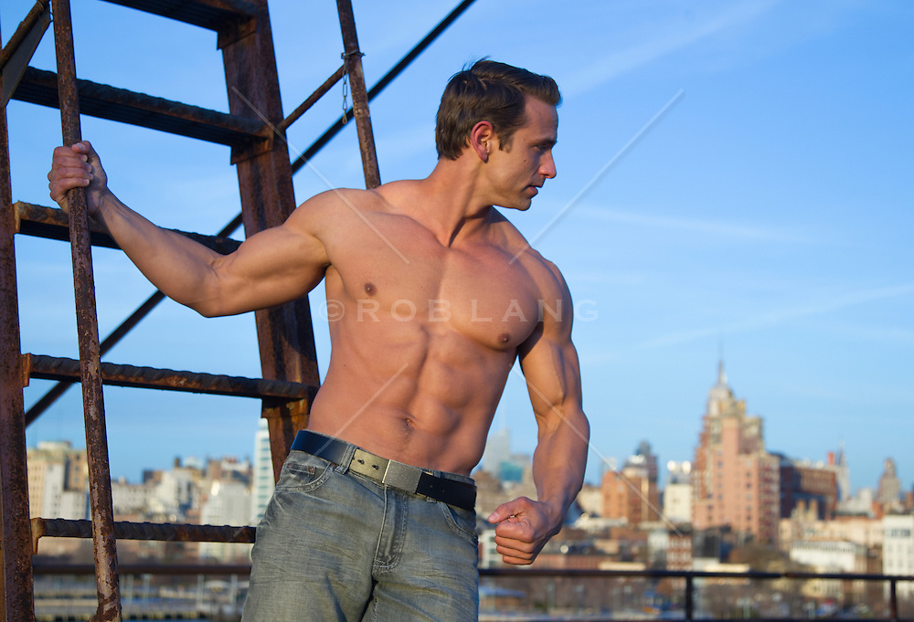 muscular man without a shirt outdoors in New York City
