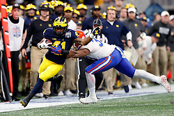 Michigan Wolverines running back Christian Turner #41 runs the ball past Florida Gators defensive back linebacker David Reese II #33 during the Chick-fil-A Peach Bowl, Saturday, December 29, 2018, in Atlanta. ( Paul Abell via Abell Images for Chick-fil-A Peach Bowl)
