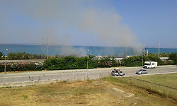 July 21, 2017 - Altidona, Italy, Italy - A fire blazing up at Pedaso near San Benedetto del Tronto on Italian Adriatic Coast on the railway. (Credit Image: © Mairo Cinquetti/Pacific Press via ZUMA Wire)