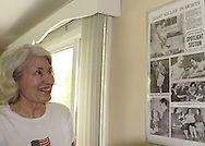 Long time member Jane Rininger looks at a framed page from the March 13, 1938 Sunday Dayton Journal hanging in the clubhouse before the finals of the 41st Weston Memorial Tennis Tournament at the Virginia Hollinger Memorial Tennis Club, Monday, May 26, 2008. Pictured in the upper left corner is Virginia Hollinger.