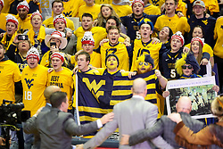 Jan 27, 2018; Morgantown, WV, USA; West Virginia Mountaineers students cheer on ESPN College Gameday on set before the Big 12/SEC challenge game between West Virginia and Kentucky at WVU Coliseum. Mandatory Credit: Ben Queen-USA TODAY Sports
