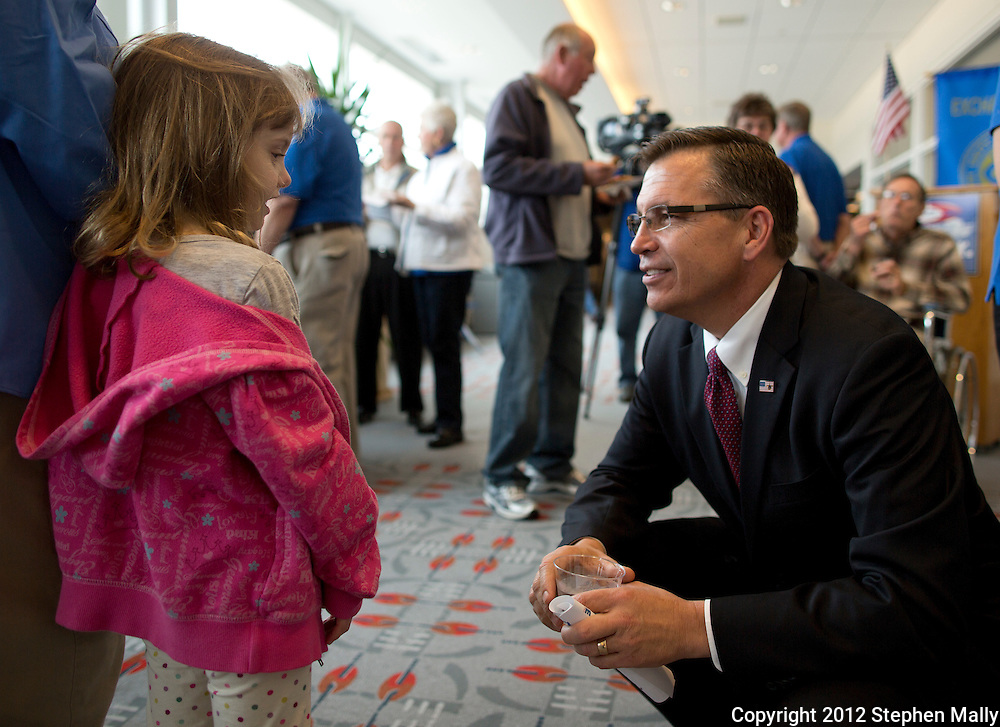 Rep. Bobby Schilling (R-Ill) talks with Abby Wilshusen, 5, of Colona, Illinois after speaking at the rededication of the Freedom Shrine at the Quad-City International Airport in Moline, Illinois on Monday, April 30, 2012. The Freedom Shrine is a set of mounted plaques with reproductions of various important historical documents.