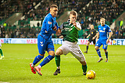 Florian Kamberi (#22) of Hibernian FC holds off James Tavernier (#2) of Rangers FC during the Ladbrokes Scottish Premiership match between Hibernian and Rangers at Easter Road, Edinburgh, Scotland on 8 March 2019.