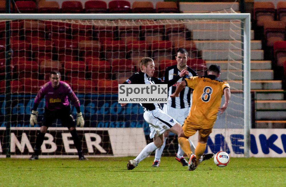 (Dunermline) Defend well as Chris Turner (Dumbarton) attacks. Dunfermline v Dumbarton Scottish Division 1 Saturday 24 November 2012. (c) Russell Sneddon | StockPix.eu