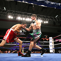 "Orlando Cruz, (green trunks)  fights against Jorge Pazos at the Kissimmee Civic Center in Kissimmee, Florida, on Friday, October 19, 2012. The Puerto Rican Cruz recently described himself as ""a proud gay man"" and the first active boxer having pronounced so, in boxing history.  Cruz won the fight via 12 round decision. (AP Photo/Alex Menendez)"