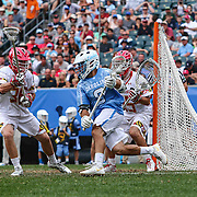 North Carolina Attackman STEVE PONTRELLO (0) attempts to score as  University of Maryland Defenseman TIM MULLER (36) defends during the second half of The NCAA Division I NATIONAL CHAMPIONSHIP GAME between North Carolina and Maryland, Monday, May. 30, 2016 at Lincoln Financial Field in Philadelphia, Pa