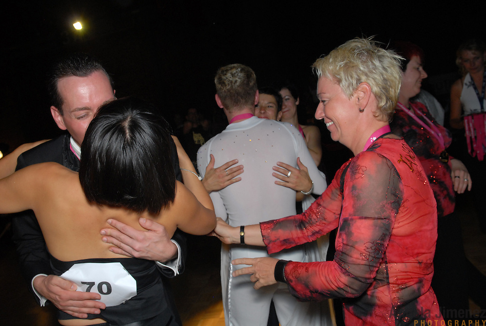 Andrea Schlinkert, right, of Berlin, Germany, and another fellow dancer greets Csaba Csetneki, left, of Hungary, after he won the silver medal in the adult men's A standard division of the same-sex ballroom dancing competition during the 2007 Eurogames at the Waagnatie hangar in Antwerp, Belgium on July 13, 2007. ..Over 3,000 LGBT athletes competed in 11 sports, including same-sex dance, during the 11th annual European gay sporting event. Same-sex ballroom is a growing sports that has been happening in Europe for over two decades.