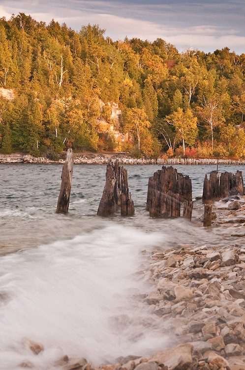 Lake Michgian shoreline and old dock pilings at Fayette State Historical Park near Garden Michigan.