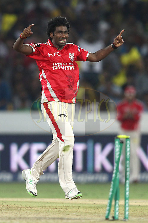 Parvinder Awana of the Kings XI Punjab celebrates bowling Pawan Negi of the Chennai Super Kings during the second semi final match of the Oppo Champions League Twenty20 between the Kings XI Punjab and the Chennai Superkings held at the Rajiv Gandhi Cricket Stadium, Hyderabad, India on the 2nd October 2014<br /> <br /> Photo by:  Shaun Roy / Sportzpics/ CLT20<br /> <br /> <br /> Image use is subject to the terms and conditions as laid out by the BCCI/ CLT20.  The terms and conditions can be downloaded here:<br /> <br /> http://sportzpics.photoshelter.com/gallery/CLT20-Image-Terms-and-Conditions-2014/G0000IfNJn535VPU/C0000QhhKadWcjYs