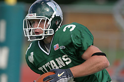 22 October 2005: Titan DB Eric Esch clutches the ball looking for room to run. The Illinois Wesleyan Titans posted a 23 - 14 home win by squeeking past the Thunder of Wheaton College at Wilder Field (the 5th oldest collegiate field in the US) on the campus of Illinois Wesleyan University in Bloomington IL