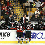 Head Coach Jim Madigan of the Northeastern Huskies speaks with his players during The Beanpot Championship Game at TD Garden on February 10, 2014 in Boston, Massachusetts. (Photo by Elan Kawesch)