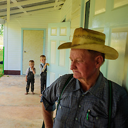 Mennnonite farmer in front of his house, Little Belize, Belize.