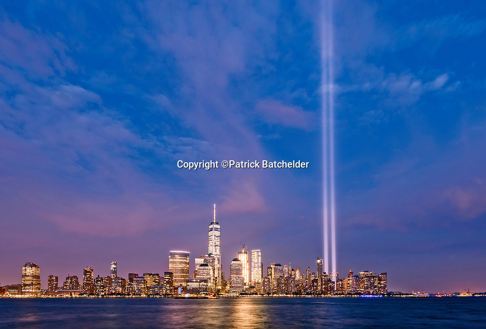 Tribute in Light, presented by Municipal Arts Society, by the 9/11 Memorial Museum. Comprising eighty-eight light bulbs positioned into two 48-foot squares that echo the shape and orientation of the Twin Towers. The illuminated memorial reaches four miles into the sky.