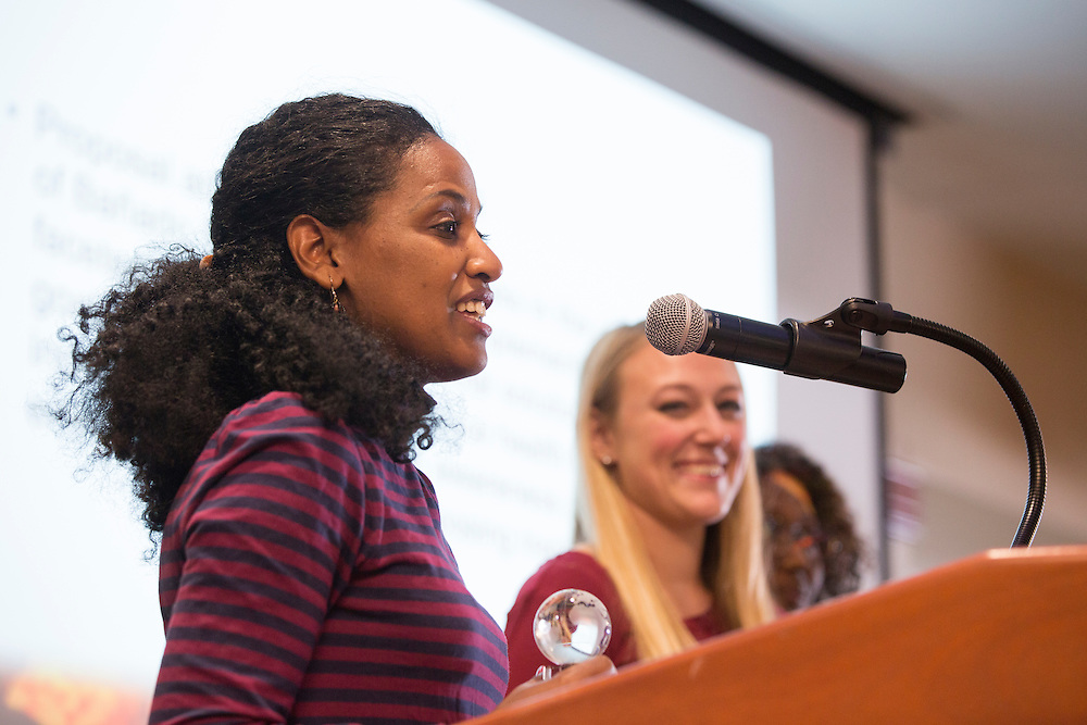 Fithi Embaye, a member of the Tranquilo Team, gives a speech after learning her team placed first in the Global Health Case Competition during The Global Engagement Awards Gala for International Education Week on November 16, 2016.