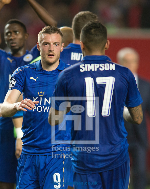 Jamie Vardy of Leicester City is greeted by team-mate Danny Simpson following the UEFA Champions League match at Ramon Sanchez Pizjuan Stadium, Seville<br /> Picture by Russell Hart/Focus Images Ltd 07791 688 420<br /> 22/02/2017