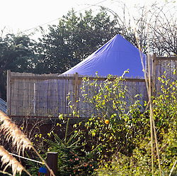 © London News Pictures. 05/01/2016. A Police police tent in the back garden of the home of former Eastenders actress Sian Blake in Erith, Kent, which has been turned into a crime scene today (05/01/2016). Sian Blake and her two children have been missing for more than three weeks. Her partner has been described as a 'high-risk missing person'. Photo credit: Grant Falvey/LNP