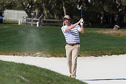 Feb 8, 2012; Pebble Beach CA, USA; Recording artist Clay Walker hits a shot from a sand trap on the second hole during the celebrity challenge of the AT&T Pebble Beach Pro-Am at Pebble Beach Golf Links. Mandatory Credit: Jason O. Watson-US PRESSWIRE