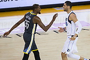 Golden State Warriors forward Kevin Durant (35) talks trash to Dallas Mavericks center Salah Mejri (50) at Oracle Arena in Oakland, California, on February 8, 2018. (Stan Olszewski/Special to S.F. Examiner)