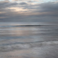 A slow shutter speed smoothes out the water  adding to the calm, peaceful mood.