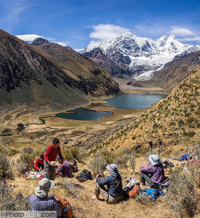 Trekkers lunch above Jahuacocha lake and Incahuain settlement, near Mount Jirishanca (Icy Beak of the Hummingbird, 6126 m or 20,098 feet). Day 8 of 9 days trekking around the Cordillera Huayhuash in the Andes Mountains, LLamac, Peru, South America. This panorama was stitched from 2 overlapping photos.