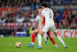 CARDIFF, WALES - Friday, September 6, 2019: Wales' Tom Lawrence (L) and Azerbaijan's Badavi Hüseynov during the UEFA Euro 2020 Qualifying Group E match between Wales and Azerbaijan at the Cardiff City Stadium. (Pic by Mark Hawkins/Propaganda)