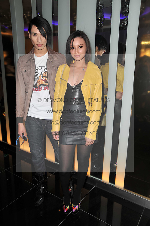 Left to right, NAT WELLER and LEAH WELLER at a party to celebrate the 15th birthday of Vogue.com held at W Hotel, Leicester Square, London W1 on 17th February 2011.