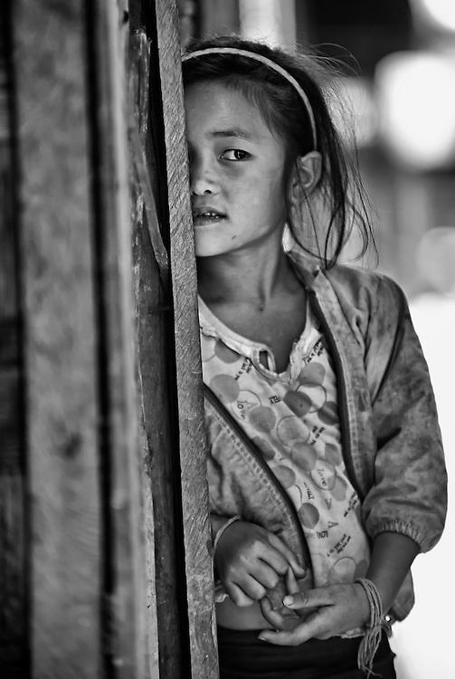 A girl in her village near Luang Prabang, Laos.