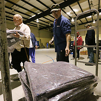 Jeff Ivey begin to pass out new blankets at the Salvation Amry gym on Carnation Street in Tupelo Wednesday evening. The Salvation Army has opened it's gym to let thos in need have a warm place to stay during this sub-freezing weather.